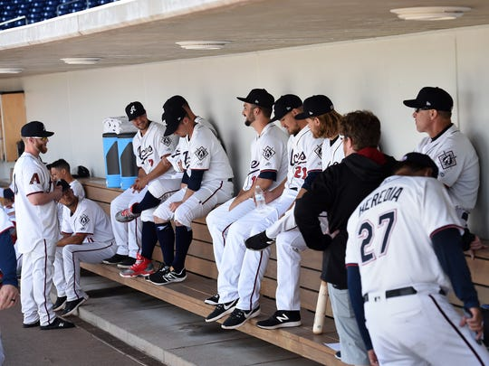 Reno Aces players hang out in the dugout during Aces Media Day at Greater Nevada Field on April 4.