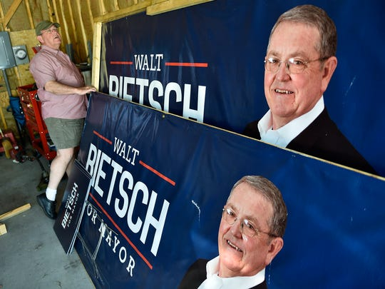 Walt Bietsch stores his large signs in a garage in a garage after colllecting some of them Tuesday evening and Wednesday, May 17, 2017. Bietsch won the Republican nomination to become  mayor during Tuesday's primary.