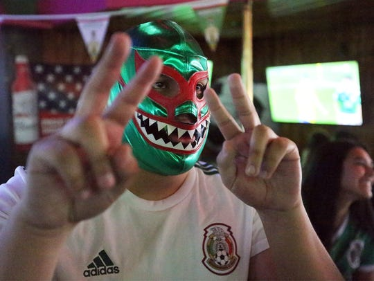 Mexico soccer fan Joshua Martinez watches the Mexico-Sweden