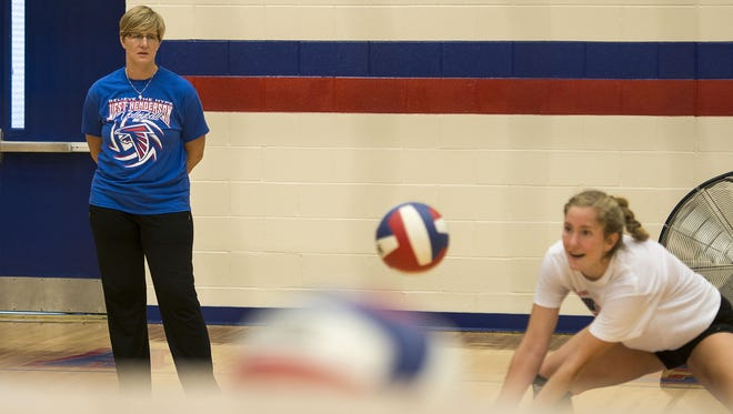 West Henderson coach Tiffany Lowrance, left, Casey Brown and the rest of the Falcons are home for Monday night's match against Roberson.