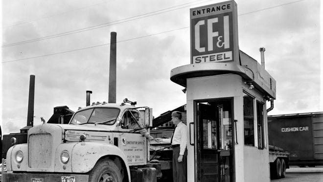 In 1966, a trucker hauling products from the recently christened CF&I Steel is stopped at the Indiana Avenue gate guard house.
