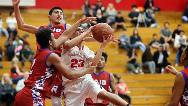 Palm Springs' Kaelan Richter is fouled as he goes up for a shot during the game against Indio in Palm Springs on Friday, February 3, 2017. Palm Springs won 64-61.
