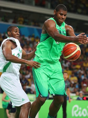 Brazil center Cristiano Silva Felicio (6) tries to grab a rebound against Nigeria forward Andy Ogide (11) in a men's preliminary round Group B basketball game at Carioca Arena 1 during the Rio 2016 Summer Olympic Games.
