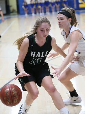 West Allis Hale's Zoe Burczyk (left) gets the ball tapped away by Germantown's Megan Ische.