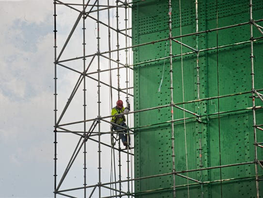Berto Leme, foreman of the tower rigging crew, climbs