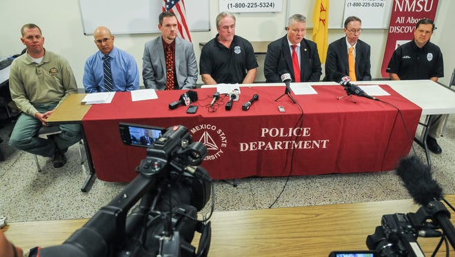 Representatives from multiple law enforcement agencies investigating gather for a news conference in November 2015 at the New Mexico State University Police department on regarding the Aug. 2, 2015, church blasts. Law enforcement urge the public to stay vigilant and continue to provide any tips. Pictured from left to right: Lt. Jon Day, DASO Bomb Squad; Captain Thomas Mora, NMSP Investigations Bureau; Lt. Casey Mullins, LCPD Criminal Investigations Section; Pete McCarthy, Resident Agent in Charge of ATF Las Cruces Bureau; Robert White, Assistant Special Agent in Charge of FBI Albuquerque Division; Jack Burkhead, Chief of the U.S. Attorney's Office Albuquerque Criminal Division; and Chief Stephen Lopez, NMSU Police Department.