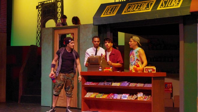 """From left, Graffiti Pete (George Ramirez), Benny (Brandon Santos), Usnavi (Melbin Borrero III), and Sonny (Keith Martinez) discuss business in New Stage Theatreworks' production of """"In the Heights."""""""