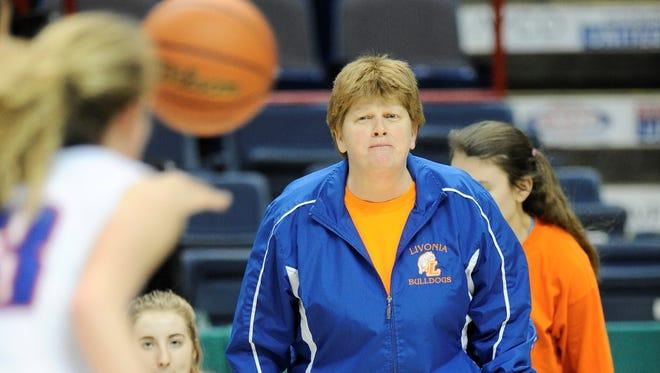 Livonia coach Karen Schuster keeps an eye on her team's ball movement on offense.