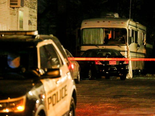 Police investigate the scene where a man and women