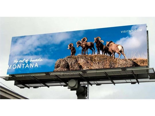 Bighorn sheep adorn a Montana tourism promotion billboard.