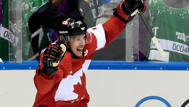 Canada forward Sidney Crosby celebrates after scoring a goal against Sweden in the second period.
