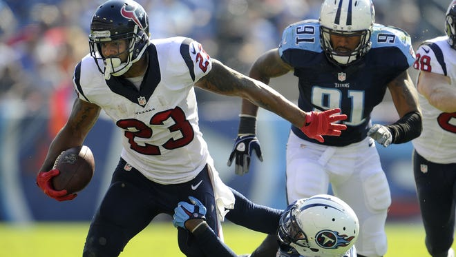 Texans running back Arian Foster pulls away from Titans outside linebacker Shaun Phillips during the second quarter on Oct. 26 at LP Field.