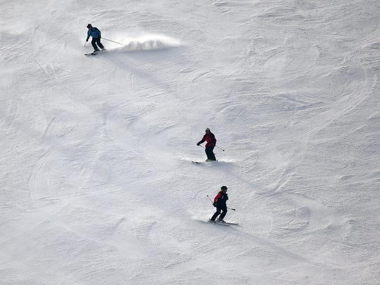 Experienced skiers negotiate a slope, Thursday, Jan.