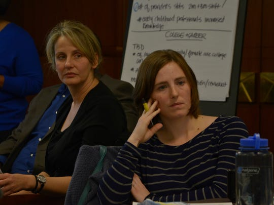 Battle Creek Unlimited President and CEO Marie Briganti, left, and Battle Creek City Commissioner Kate Flores listen during discussions at the BC Vision action team co-chairs meeting Wednesday at the W.K. Kellogg Foundation building in Battle Creek.