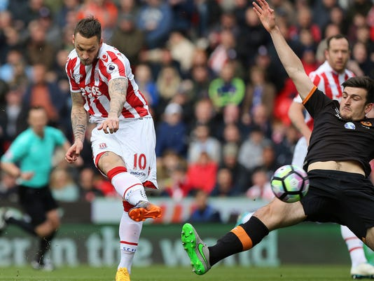 Stoke City's Marko Arnautovic scores his side's first goal of the game during the Premier League soccer match between Stoke City and Hull City at the bet365 Stadium, Stoke, England. Saturday April 15, 2017. (Barrington Coombs/PA via AP)