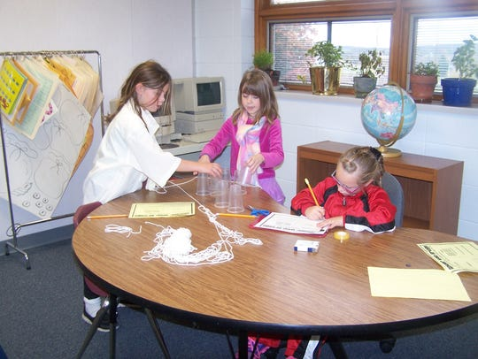 Horizon Elementary School second-graders create a spider