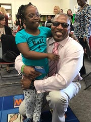 J.V. Forrestal Elementary School student Zechia Mickler, 6, of Beacon, hugs her dad Steve Mickler during a ceremony in her honor Friday.  Zechia has been selected as one of three ambassadors for the Go the Maria Fareri Children's Hospital's Distance Walk and Family Fun Day.