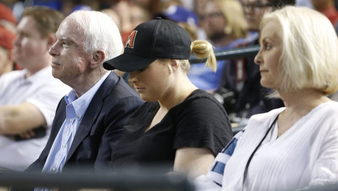 Sen. John McCain watches a Diamondbacks vs. Dodgers game with his daughter Meghan McCain and wife Cindy McCain at Chase Field in Phoenix, Ariz. on August 10, 2017.