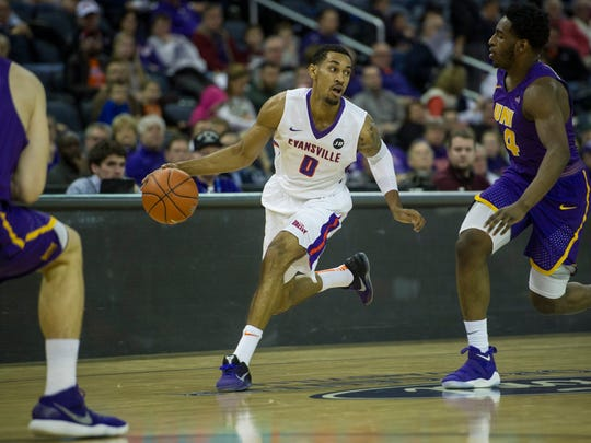 University of Evansville's Ryan Taylor (0) takes the ball down the court guarded by Northern Iowa's Tywhon Pickford (4) in the first half at the Ford Center on Wednesday, Jan. 31, 2018. The Purple Aces defeated the Panthers 57-49.