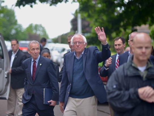 Sen. Bernie Sanders waves to supporters after addressing