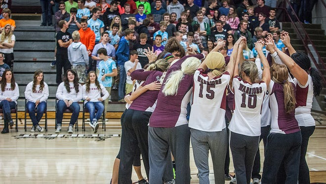 Parents of Wes Del High School volleyball players play a quick game dressed as their state-bound student athletes during a pep rally at the school Friday afternoon.