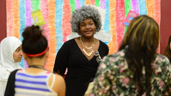 Delia David, portraying Maya Angelou, gives her speech of her historical figure. Eighth grade students at Janis E. Dismus Middle School created Living Wax Museum representing scientists, mathematicians and writers Thursday May 18, 2017.