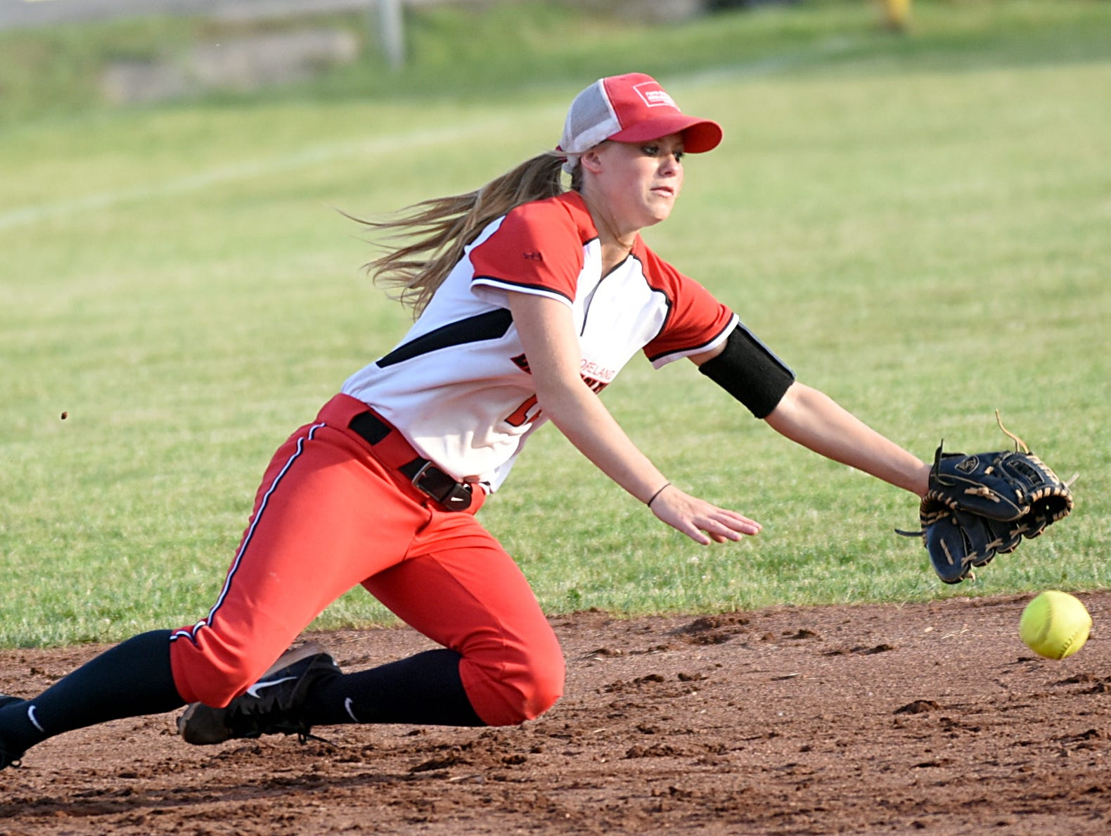Westmoreland High junior shortstop Savannah Whiticker makes a diving attempt to catch a ground ball up the middle.
