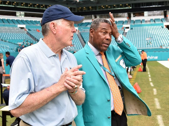 Nov 4, 2018; Miami Gardens, FL, USA; Miami Dolphins former quarterback Bob Griese (left) talks with Dolphins former player Nat Moore (right) before a game against New York Jets at Hard Rock Stadium. Mandatory Credit: Steve Mitchell-USA TODAY Sports