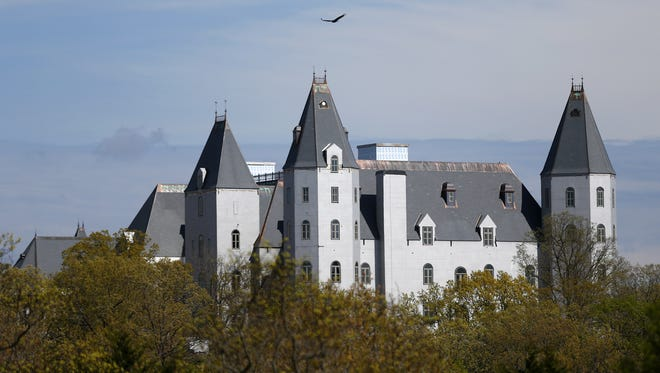 The top of the Pensmore, a 72,000-square-foot house to the south of Highlandville, is visible over the top of the trees.
