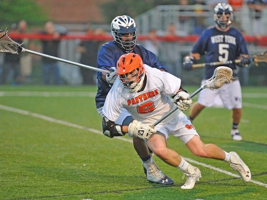 Max Haldeman works his way past a West York defender and eventually scores a goal. Central York defeated West York 13-12 to win the 2013 YAIAA boys' Lacrosse championship. GameTimePA.com - MIKE ZORTMAN