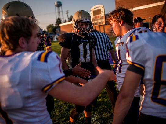 Captains from Delone Catholic and Union City (Tenn.), shake hands before the coin toss in McSherrystown on Friday, Sept. 18, 2015. Jeff Lautenberger Ñ For GameTimePA.com
