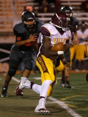 Valley's Segun Oyeku carries the football against Aztec Friday at Fred Cook Memorial Stadium in Aztec.