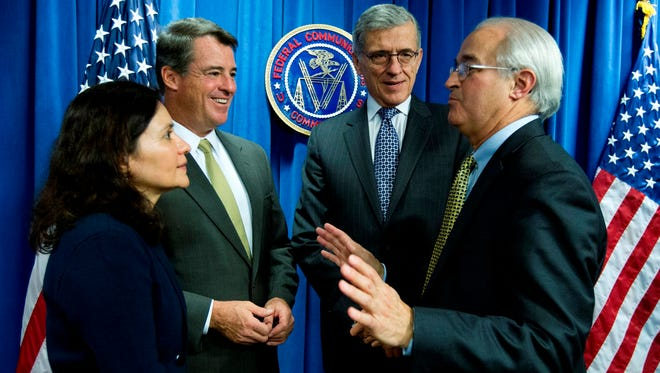 From left; Federal Trade Commission (FTC) Chair Edith Ramirez, Maryland Attorney General Doug Gansler, Federal Communications Commission (FCC) Chairman Tom Wheeler and Vermont Attorney General William H. Sorrell, speak after a news conference in Washington, Wednesday, Oct. 8, 2014, where it was announced that AT&T will pay $80 million to FTC for consumer refunds in mobile cramming case, which is part of combined $105 million settlement with FTC and FCC.