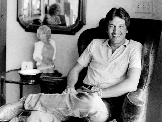George Strait relaxes July 19, 1983, in the Music Row offices of his record label, MCA, during a break in touring.