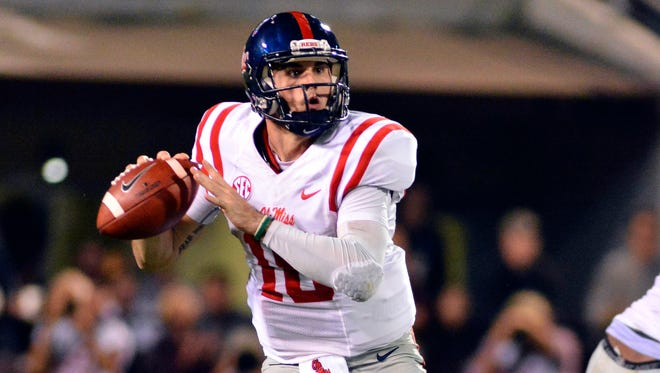 Quarterback Chad Kelly (10) drops back to pass during the second quarter of the game against the Mississippi State Bulldogs at Davis Wade Stadium. He's ranked among the top 101 players in the country, according to Pro Football Focus.