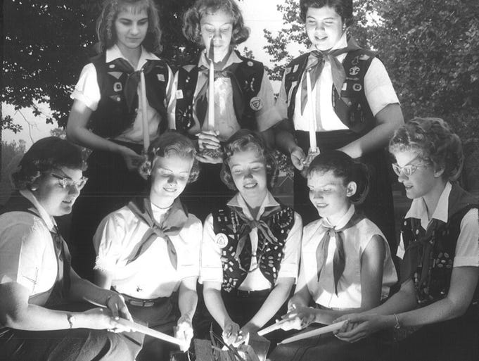 Eight Indianapolis area Camp Fire Girls received the torch bearer award at Christian Park in 1959.