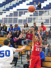 Falcons sophomore point guard Robert Franco shoots a 3-pointer in the third quarter Monday at Carlsbad JV.