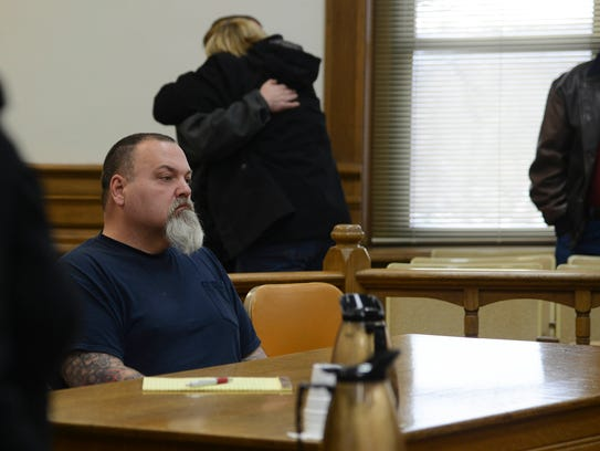 Tait Otis Purk, 51, ofTama, sits in court Friday after