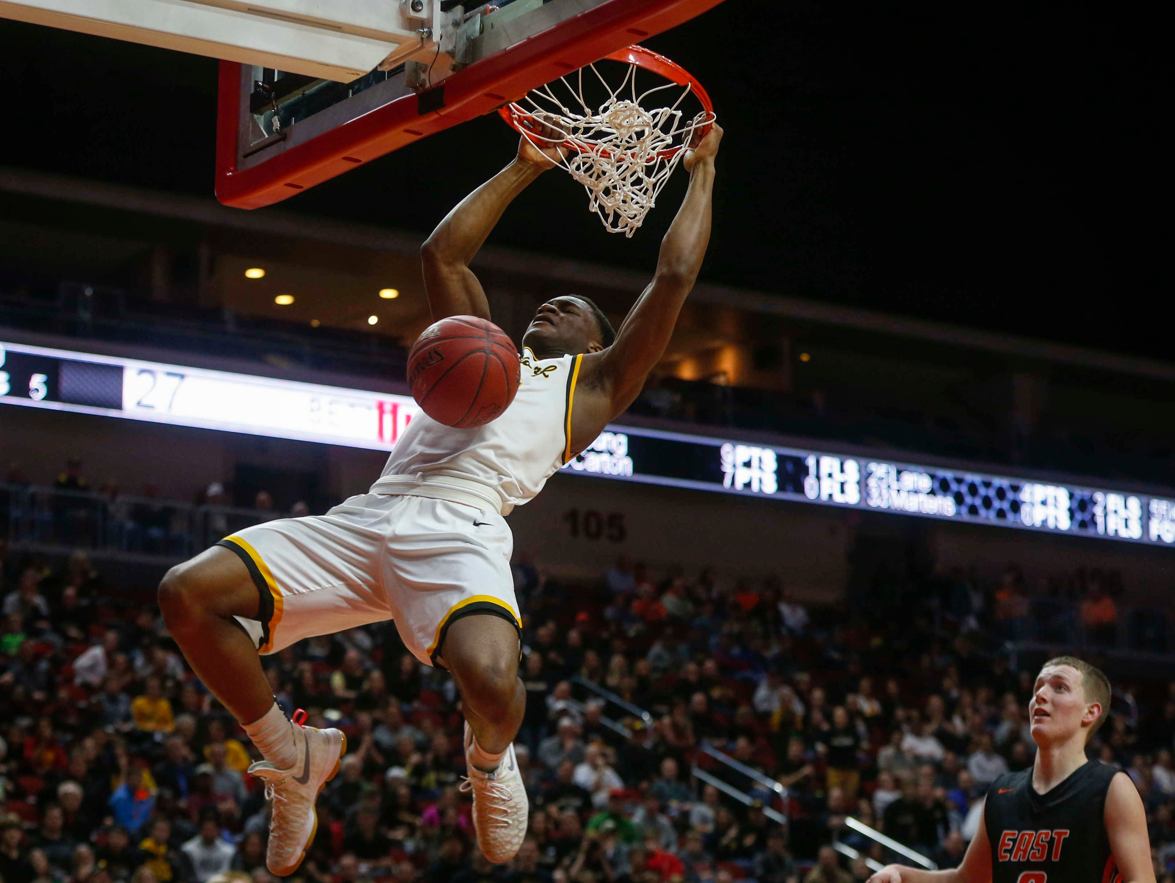 Bettendorf senior Suni Lane throws down one of his two dunks against Sioux City East during the Iowa High School state basketball tournament at Wells Fargo Arena in Des Moines on Wednesday, March 8, 2017.