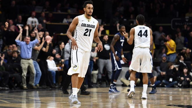 Colorado guard Derrick White (21) reacts to his three-point shot in the final seconds of the second half.