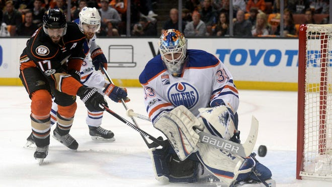 Anaheim Ducks center Ryan Kesler (17) moves in for the rebound as Edmonton Oilers defenseman Adam Larsson (6) helps goalie Cam Talbot (33) defend the goal during the second period in Game 2.