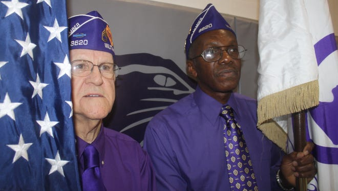 U.S. Army veteran Tony Murphy, left, a Westwood resident who served in the Korean War, and Army veteran James Kennedy, a Roselawn resident who served in the Vietnam War, presented the colors at a memorial Elder High School Mass in 2013 to honor 11 Elder alumni who were killed in the Vietnam War.
