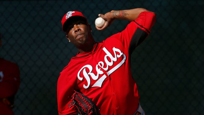 FILE - In this Feb. 15, 2014, file photo, Cincinnati Reds relief pitcher Aroldis Chapman throws during spring training baseball practice in Goodyear, Ariz. Chapman, with two black eyes, has returned to the Reds' clubhouse four days after being hit in the face by a line drive. The 26-year old left-hander had surgery at Banner Good Samaritan Medical Center, Thursday, March 20, 2014, to repair a broken bone above his left eye.