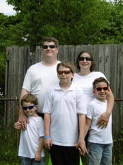 Benjamin and Michelle Weston are pictured with their children, Connor, Logan and Dylan.