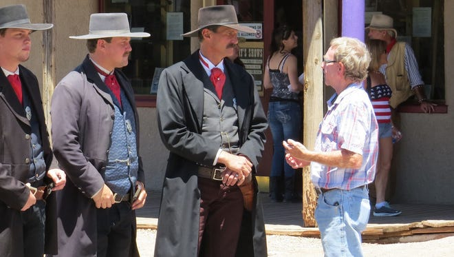 A visitor to Tombstone chats with historical reenactors on Allen Street.