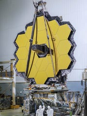 NASA scientists inspect the mirrors of the James Webb Space Telescope, scheduled to be launched into Earth's orbit next year. The James Webb Space Telescope will further advance research into habitable planets outside our own solar system, such as LHS 1140b discovered by MIT researcher, Dr. Jason Dittmann.