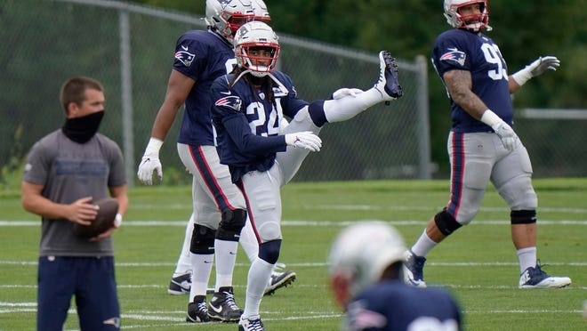 New England Patriots cornerback Stephon Gilmore (24) stretches during an NFL football training camp practice, Monday, Aug. 17, 2020, in Foxborough, Mass.