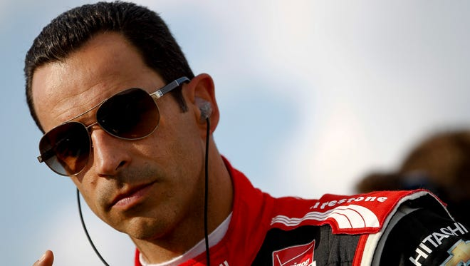 Helio Castroneves of Brazil, driver of the #3 Hitachi Team Penske Chevrolet, stands on the grid during qualifying for the ABC Supply Wisconsin 250 at The Milwaukee Mile on Aug. 16, 2014 in West Allis, Wisc.