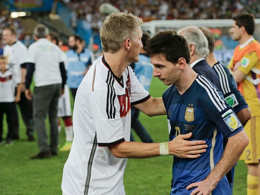 Germany's Bastian Schweinsteiger, left, consoles Argentina's Lionel Messi after the World Cup final soccer match between Germany and Argentina at the Maracana Stadium in Rio de Janeiro, Brazil, Sunday, July 13, 2014. Germany won the match 1-0 . (AP Photo/Matthias Schrader)