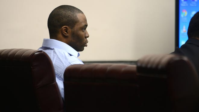 Vincent Moore listens to the proceedings during his murder trial on Thursday.